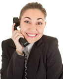 Emotional woman with a telephone. Emotional woman in business clothing with a telephone Stock Photos