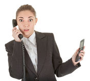 Emotional woman with a telephone. Emotional woman in business clothing with a telephone Royalty Free Stock Photos