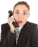 Emotional woman with a telephone. Emotional woman in business clothing with a telephone Stock Images