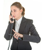 Emotional woman with a telephone. Emotional woman in business clothing with a telephone Royalty Free Stock Image