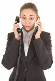 Emotional woman with a telephone Royalty Free Stock Image
