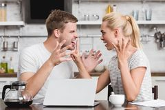 emotional young couple arguing and looking at each other relationship difficulties royalty free stock photography