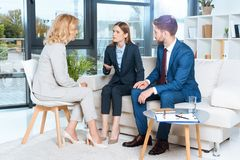 emotional young couple and psychologist during therapy stock image