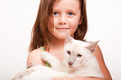 Emotional young girl with cat. Stock Photo