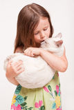 Emotional young girl with cat. Stock Photos