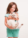 Emotional young girl with cat. Royalty Free Stock Photos