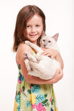 Emotional young girl with cat. Royalty Free Stock Images