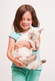 Emotional young girl with cat. Royalty Free Stock Photography