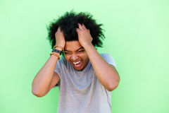 Emotional young man with hands in hair Royalty Free Stock Photo