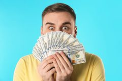 Emotional young man with money royalty free stock photos