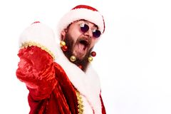 Young emotional bearded man in a Christmas costume. royalty free stock images