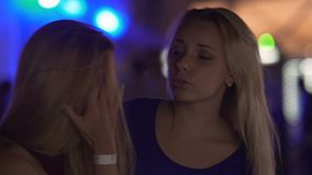 Emotional young woman crying after breakup, supportive female friend hugging her. Stock footage stock footage
