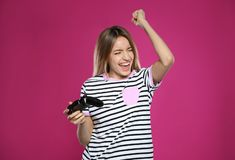 Emotional young woman playing video games with controller royalty free stock photo