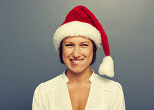 Emotional young woman in red christmas hat Royalty Free Stock Image