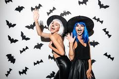 Emotional young women in halloween costumes Stock Photo