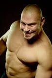 Emotionales Portrait des muskulösen konkurrenzfähigen Mannes Stockbild