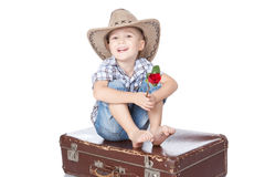 Emotionally boy sitting on suitcase over white Royalty Free Stock Photo