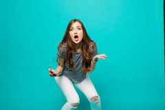 Emotionally brunette gesturing by hands shocking screaming at camera. Royalty Free Stock Photography