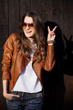 Emotionally brunette girl gesturing peace and posing at street. Stock Photography