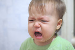 Emotionally crying baby Stock Image