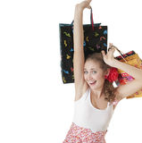 Emotionally happy young girl  holding shopping gift bags. Royalty Free Stock Photos