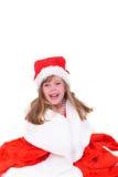 Emotioneel portret van een vrolijk meisje in rode die kleding op witte achtergrond wordt geïsoleerd Nieuw jaar Stock Foto