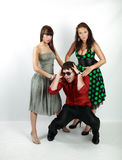 Emotions. Attractive emotional young man between two girls stock photos