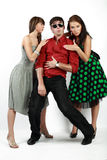 Emotions. Attractive emotional young man between two girls royalty free stock images