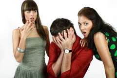 Emotions. Attractive emotional young man between two girls stock images