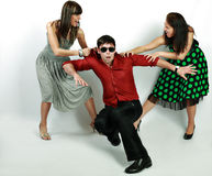 Emotions. Attractive emotional young man between two girls royalty free stock photos