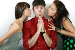 Emotions. Attractive emotional young man between two girls stock photo