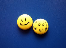 Emotions. 2 different emotions shown by round smiles Royalty Free Stock Photos