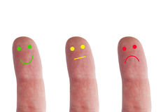 Emotions. Three Fingers with various emotions Stock Images