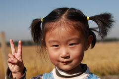 Emotions. Happy Chinese little girl countryside outdoors one person Stock Photo