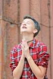 Emotions of adolescence. Prayer to god. Emotions of adolescence. Pray to God. Teen girl appeals to God through prayer stock photo
