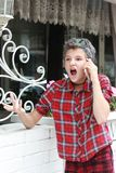Emotions of adolescence. Scream and scandal. Teen girl swears with someone on the phone. Generational conflict stock images