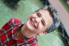 Emotions of adolescence. Smile and joy. Teen girl with creative hairdo royalty free stock image