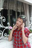 Emotions of adolescence. Talking on the smartphone. Pensive romantic portrait of a teenager girl stock photos