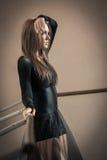 Emotions of a ballet dancer at ballet barre Stock Photos