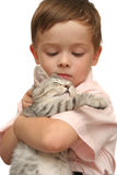 Emotions of the boy. Which holds on hands of a grey kitten Royalty Free Stock Photo