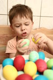 Emotions of the boy and easter. Eggs on a table Stock Image