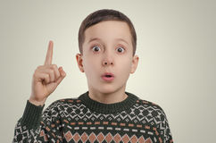 Emotions. Boy have an idea looking at camera and holding his fin Royalty Free Stock Photos