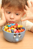 Emotions of the child. Which looks at sweets Stock Photography