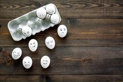 Emotions in communication at social media. Faces drawn on eggs. Happy, smile, sad, angry, in love, saticfied, laughing. Emotions in communication at social media Stock Photography