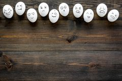 Emotions in communication at social media. Faces drawn on eggs. Happy, smile, sad, angry, in love, saticfied, laughing. Emotions in communication at social media Stock Photos