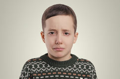 Emotions. The crying boy portrait. Stock Photos