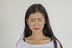 Emotions disgust. Beautiful Asian young woman with disgusted face. Sad expression, sad emotion, despair, sadness,emotions disgust Stock Photo