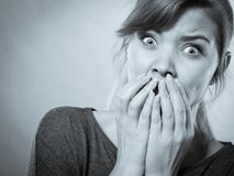 Nervous lady expressing fear. stock images