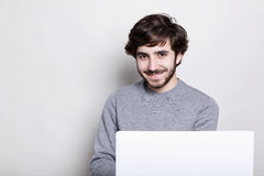 Emotions, human, modern technologies and lifestyle concept. Happy attractive young bearded guy enjoying free wireless connection, Stock Photography