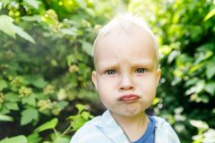 Emotions in the infant`s view, confusion and indignation in the child`s view.  stock photography